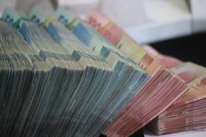 Dollar bills stacked together