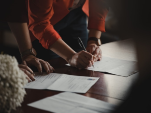 An investor signing a hard money loan application